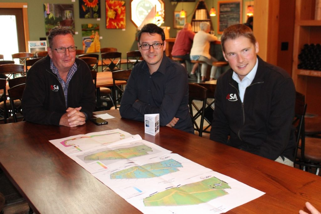 Mark Sylvester, Alex Sylvester and John Carley of ASAP Geomatix reviewing the maps for 40 Knots Vineyard.