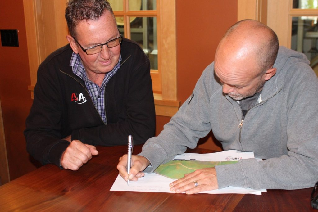 Mark Sylvester of ASAP Geomatix and Layne Craig, Owner of 40 Knots Vineyard and Estate Winery reviewing the data from the pilot project