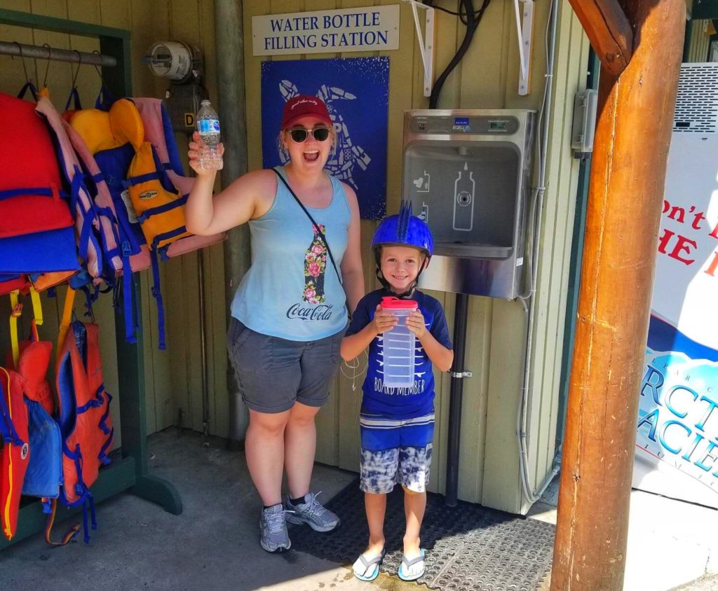 guests at the Lakeside Resort in Oliver, BC using a water bottle refill station instead of using single-use plastic water bottles