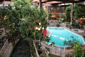 view of the garden atrium and pool at the Prestige Vernon Lodge in Vernon, North Okanagan, British Columbia.