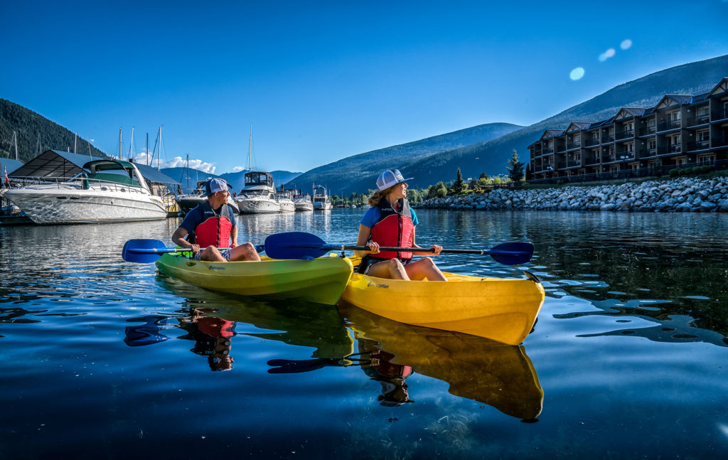 kayakers in the bay by the Prestige Hotel in British Columbia