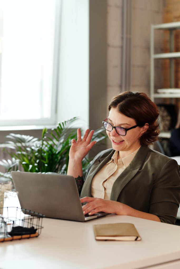 image of a woman interacting in a virtual event while working from home