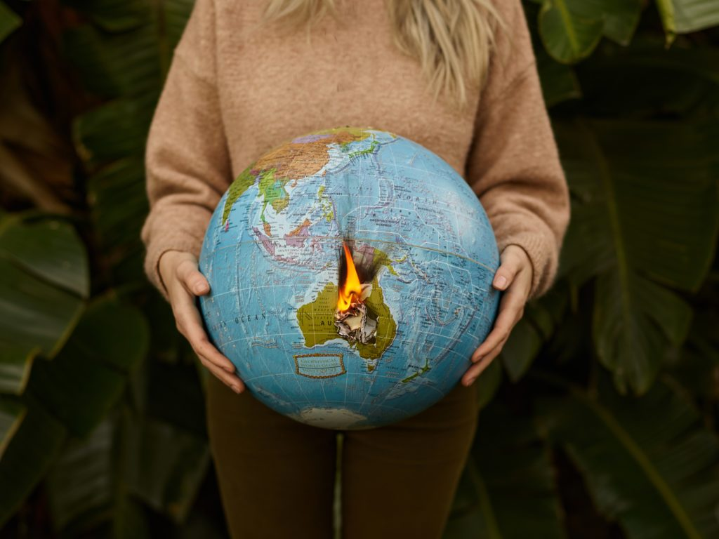 a person holding a globe between their hands